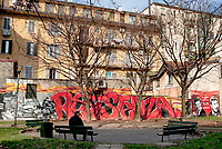Milano, quartiere Dergano, periferia nord. Murale dedicato alla Resistenza antifascista dei partigiani Elio Sammarchi e Sergio Bassi --- Milan, Dergano district, north periphery. Murales dedicated to the antifascist Resistance of the partisans Elio Sammarchi and Sergio Bassi