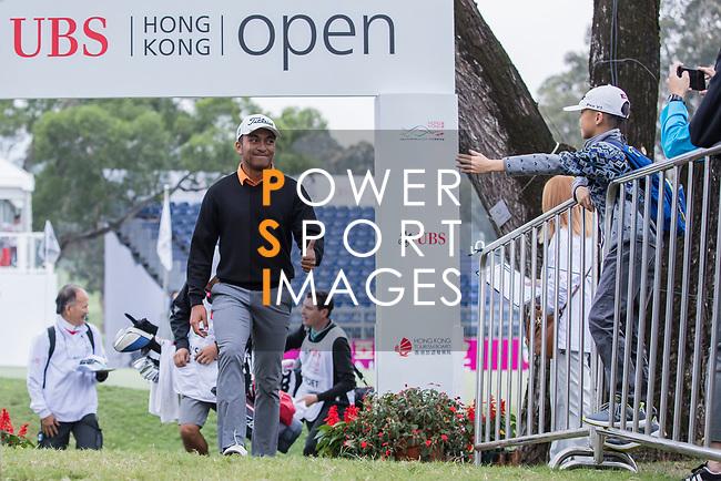 Leon D'souza of Hong Kong interacts with a little fan during the day three of UBS Hong Kong Open 2017 at the Hong Kong Golf Club on 25 November 2017, in Hong Kong, Hong Kong. Photo by Yu Chun Christopher Wong / Power Sport Images