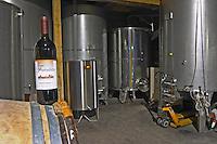 Cuvee Premieres Braises 5. Domaine Fontedicto, Caux. Pezenas region. Languedoc. Barrel cellar. Stainless steel fermentation and storage tanks. France. Europe. Bottle.