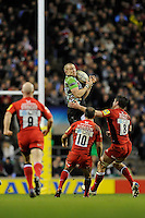 Mike Brown of Harlequins out jumps Charlie Hodgson (left) and Ernst Joubert of Saracens during the Aviva Premiership match between Harlequins and Saracens at Twickenham on Tuesday 27 December 2011 (Photo by Rob Munro)