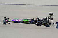 Sept. 29, 2012; Madison, IL, USA: NHRA top fuel dragster driver Larry Dixon being towed back to the pits during qualifying for the Midwest Nationals at Gateway Motorsports Park. Mandatory Credit: Mark J. Rebilas-