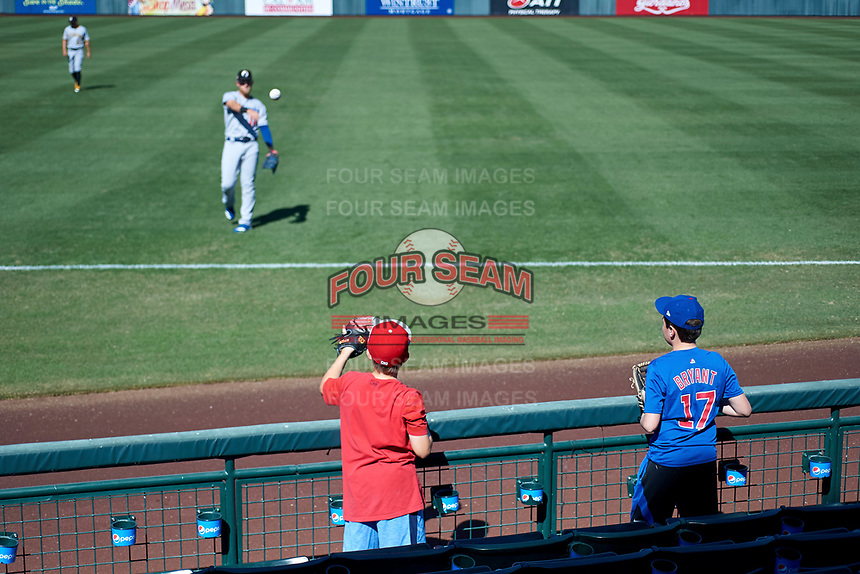 Glendale Desert Dogs first baseman Matt Beaty (17), of the Los Angeles Dodgers organization, plays catch with some young fans before an Arizona Fall League game against the Mesa Solar Sox on October 28, 2017 at Sloan Park in Mesa, Arizona. The Solar Sox defeated the Desert Dogs 9-6. (Zachary Lucy/Four Seam Images)