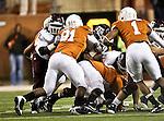 Texas Longhorns defensive tackle Kheeston Randall (91) and Texas Longhorns linebacker Keenan Robinson (1) in action during the Texas A & M vs. Texas Longhorns football game at the Darrell K Royal - Texas Memorial Stadium in Austin, Tx. Texas A & M defeats Texas 24 to 17....