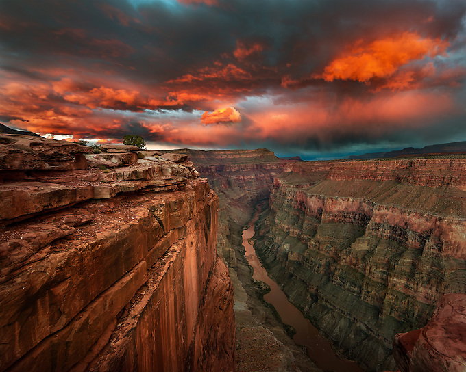 The afterglow of the setting sun illuminates the Colorado River under Toroweap, a remote location in the Grand Canyon. <br /> Artist Edition: 15/200 Limited