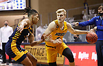 SIOUX FALLS, SD - MARCH 7: Sam Griesel #5 of the North Dakota State Bison drives on Zion Williams #0 of the UMKC Kangaroos during the Summit League Basketball Tournament at the Sanford Pentagon in Sioux Falls, SD. (Photo by Richard Carlson/Inertia)