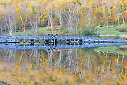 Crawford Notch State Park - Reflection of dam in Willey Pond,along the Saco River, at the Willey House Historical Site in the White Mountains, New Hampshire USA during the autumn months.