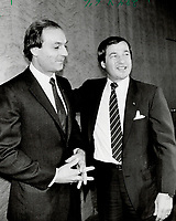 1985 FILE PHOTO - ARCHIVES -<br /> <br /> New job for The Flower: Guy Lafleur (left) is welcomed into the Hockey Canada fold by Otto Jelinek, the federal sports minister. Lafleur will help groom Team Canada for the 1988 Olympic Games in Calgary.<br /> <br /> <br /> PHOTO - Goode, Jeff<br /> <br /> PHOTO :  Jeff Goode - Toronto Star Archives - AQP