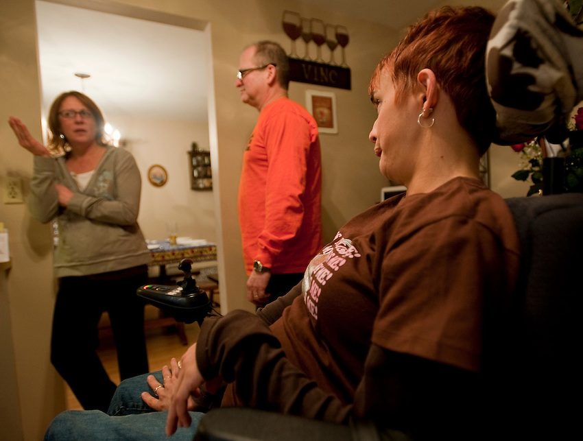 Kara and her sister talk before a family dinner at their parents' house. Photo by James R. Evans ©