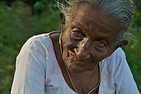 Old women Dambulla Cave Temple Sri Lanka dating to the first Century BC.