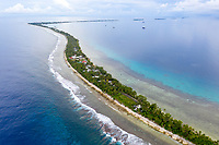 An aerial view of Fongafale island, the home to the Tuvaluan capital of Funafuti. Located in the South West Pacific Ocean, Tuvalu is the world's 4th smallest country and is one of the most vulnerable to climate change impacts including sea level rise, drought and extreme weather events. Tuvalu - March, 2019.