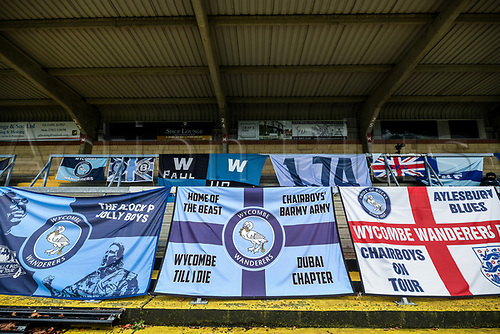 21st November 2020; Adams Park Stadium, Wycombe, Buckinghamshire, England; English Football League Championship Football, Wycombe Wanderers versus Brentford; Flags fill the home end at Adams Park at an empty stadium  due to the pandemic