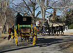 """Carriages pass on Colonial Williamsburg street Virginia, wagon, carriage, Colonial Williamsburg Virginia is historic district 1699 to 1780 which made colonial Virgnia's Capital, for most of the 18th century Williamsburg was the center of government education and culture in Colony of Virginia, George Washington, Thomas Jefferson, Patrick Henry, James Monroe, James Madison, George Wythe, Peyton Randolph, and others molded democracy in the Commonwealth of Virginia and the United States, Motto of Colonial Williamsburg is """"The furture may learn from the past,"""""""