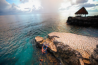 Montego Bay, Jamaica. Couple jumping from bridge and swimming in the ocean at their Tensing Pen hotel.  Isabel & Brendan.