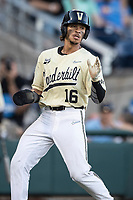 Vanderbilt Commodores third baseman Austin Martin (16) scores a run against the Michigan Wolverines during Game 3 of the NCAA College World Series Finals on June 26, 2019 at TD Ameritrade Park in Omaha, Nebraska. Vanderbilt defeated Michigan 8-2 to win the National Championship. (Andrew Woolley/Four Seam Images)
