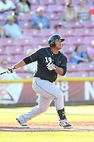 Trae Santos #19 of the Eugene Emeralds bats against the Salem-Keizer Volcanoes at Volcanoes Stadium on July 27, 2014 in Keizer, Oregon. Salem-Keizer defeated Eugene, 9-1. (Larry Goren/Four Seam Images)