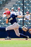 Chris Rahl #18 of the Harrisburg Senators follows through on his swing against the Richmond Flying Squirrels at The Diamond on July 22, 2011 in Richmond, Virginia.  The Squirrels defeated the Senators 5-1.   (Brian Westerholt / Four Seam Images)