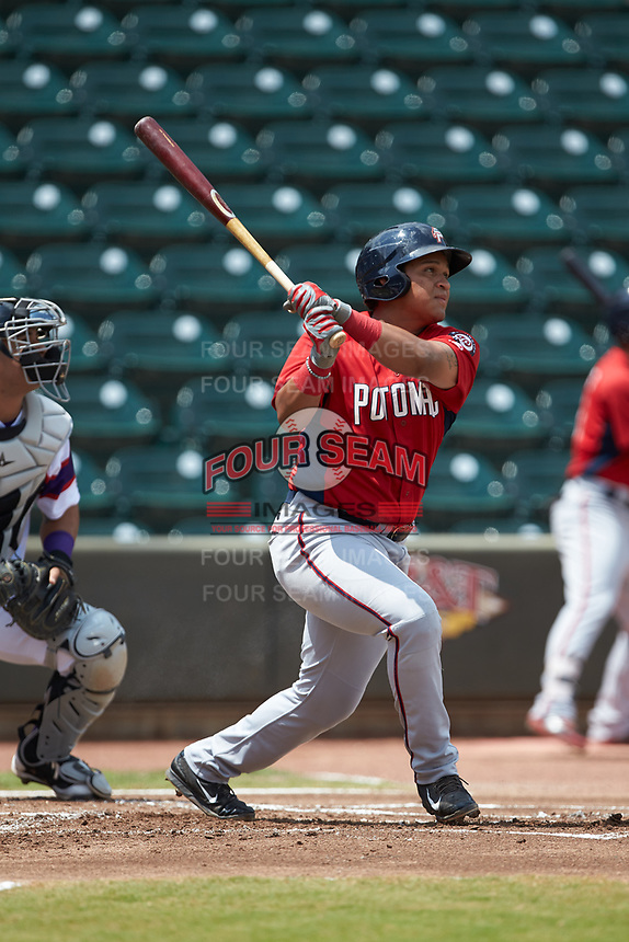 Aldrem Corredor (29) of the Potomac Nationals follows through on his swing against the Winston-Salem Rayados at BB&T Ballpark on August 12, 2018 in Winston-Salem, North Carolina. The Rayados defeated the Nationals 6-3. (Brian Westerholt/Four Seam Images)