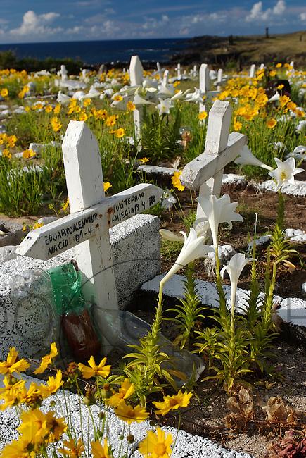 Overlooking the sea near Ahu Tahai, Hanga Roa's colorful cemetery is full of tombstones with Polynesian names.