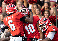 ATHENS, GA - SEPTEMBER 11: Jamon Dumas-Johnson #10 of the Georgia Bulldogs is congratulated by his teammates after running an interception back for a touchdown during a game between University of Alabama Birmingham Blazers and University of Georgia Bulldogs at Sanford Stadium on September 11, 2021 in Athens, Georgia.