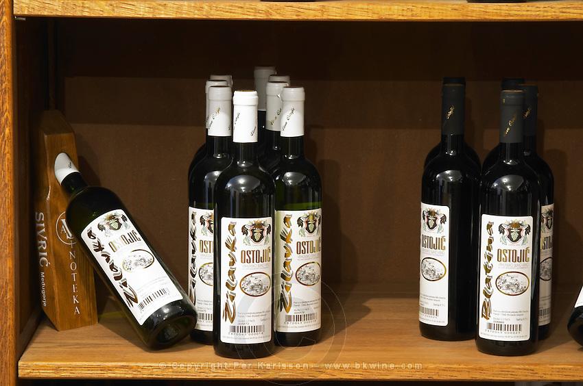 In the winery wine shop, display of various wines from the Ostojic winery Podrum Vinoteka Sivric winery, Citluk, near Mostar. Federation Bosne i Hercegovine. Bosnia Herzegovina, Europe.