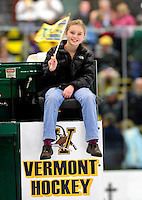 6 November 2009: University of Vermont Catamount fan Eliza Jackson rides the Zamboni ice resurfacing vehicle after the first period of play against the visiting University of Massachusetts Lowell River Hawks at Gutterson Fieldhouse in Burlington, Vermont. The Hockey East rivals battled to a 3-3 tie. Mandatory Credit: Ed Wolfstein Photo