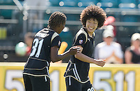 Eriko Arakawa, center, is congratulated after her goal by Formiga. FC Gold Pride defeated the Boston Breakers 2-1 at Buck Shaw Stadium in Santa Clara, California on April 5th, 2009.