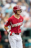 Arkansas Razorbacks outfielder Andrew Benintendi (16) runs to first base against the Virginia Cavaliers in Game 1 of the NCAA College World Series on June 13, 2015 at TD Ameritrade Park in Omaha, Nebraska. Virginia defeated Arkansas 5-3. (Andrew Woolley/Four Seam Images)