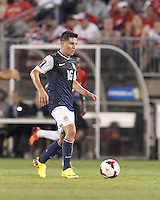 USMNT midfielder Jose Torres (16) brings the ball forward.  In CONCACAF Gold Cup Group Stage, the U.S. Men's National Team (USMNT) (blue/white) defeated Costa Rica (red/blue), 1-0, at Rentschler Field, East Hartford, CT on July 16, 2013.