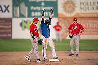 Missoula Osprey first baseman Joe Robbins (26) celebrates after hitting a double as shortstop Livan Soto (7) and second baseman Justin Jones (33) look on during a Pioneer League game against the Orem Owlz at Ogren Park Allegiance Field on August 19, 2018 in Missoula, Montana. The Missoula Osprey defeated the Orem Owlz by a score of 8-0. (Zachary Lucy/Four Seam Images)