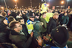 © Joel Goodman - 07973 332324 . 26/10/2016 . Trafford , UK . Police separate fighting fans outside Old Trafford after the Premier League derby between Manchester United and Manchester City . Photo credit : Joel Goodman