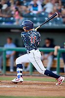 Jacksonville Jumbo Shrimp second baseman Isan Diaz (11) follows through on a swing during a game against the Mobile BayBears on April 14, 2018 at Baseball Grounds of Jacksonville in Jacksonville, Florida.  Mobile defeated Jacksonville 13-3.  (Mike Janes/Four Seam Images)