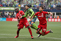 SEATTLE, WA - NOVEMBER 10: Victor Rodriguez #8 of the Seattle Sounders FC watches his shot score the game's second goal after splitting between Chris Mavinga #23 and Omar Gonzalez #44 of Toronto FC during a game between Toronto FC and Seattle Sounders FC at CenturyLink Field on November 10, 2019 in Seattle, Washington.