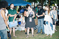 People gathered near the free-food distribution area to challenge a pro-Hillary supporter in the protest area in FDR Park outside of the secure area surrounding the Democratic National Convention at the Wells Fargo Center in Philadelphia, Pennsylvania, on Wed., July 27, 2016.