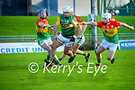 Mikey Boyle, Kerry in action against Diarmuid Byrne, Carlow and Aaron Amond, Carlow during the Joe McDonagh hurling cup fourth round match between Kerry and Carlow at Austin Stack Park on Saturday.
