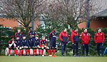 Youth players watching the first team training