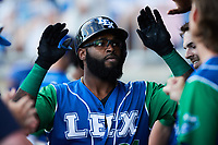 Courtney Hawkins (24) of the Lexington Legends is congratulated by teammates after hitting a home run against the High Point Rockers at Truist Point on June 16, 2021, in High Point, North Carolina. The Legends defeated the Rockers 2-1. (Brian Westerholt/Four Seam Images)