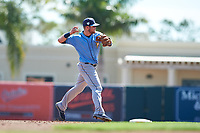 Tampa Bay Rays third baseman Christian Arroyo (22) throws to first base during a Grapefruit League Spring Training game against the Baltimore Orioles on March 1, 2019 at Ed Smith Stadium in Sarasota, Florida.  Rays defeated the Orioles 10-5.  (Mike Janes/Four Seam Images)