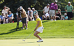The crowd and Morgan Pressel watched the ball move slowly before stopping at the 16th hole during Wegmans LPGA in Pittsford, NY.