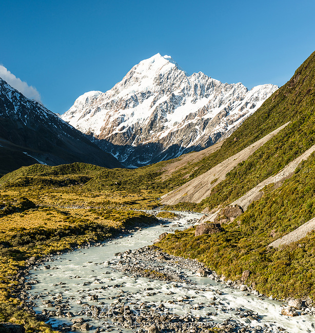 Aoraki Mount Cook 3724m highest mountain of Southern Alps, viewed through Hooker Valley with Hooker River in foreground, Aoraki Mount Cook National Park, UNESCO World Heritage Area,  Mackenzie Country, New Zealand, NZ