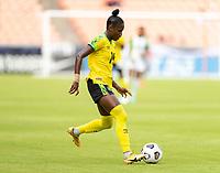 HOUSTON, TX - JUNE 10: Deneisha Blackwood #14 of Jamaica passes the ball during a game between Nigeria and Jamaica at BBVA Stadium on June 10, 2021 in Houston, Texas.