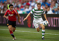 July 16, 2010 Rafael Da Silva No. 21 and James Forrest No. 49 of Celtic FC during an international friendly between Manchester United and Celtic FC at the Rogers Centre in Toronto.