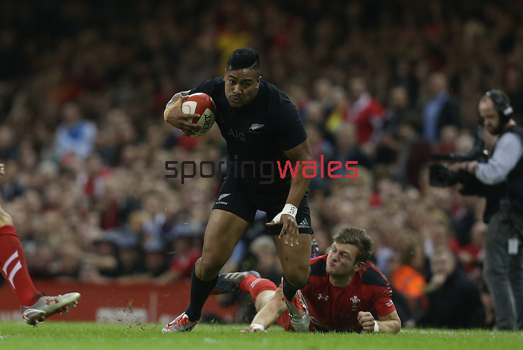 Wales outside half Dan Biggar runs in to tap tackle All Blacks wing Julian Savea.<br /> Dove men Series 2014<br /> Wales v New Zealand<br /> 22.11.14<br /> ©Steve Pope -SPORTINGWALES