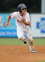 Infielder Sean Coyle (5) of the Greenville Drive, Class A affiliate of the Boston Red Sox, in a game against the Lexington Legends on August 5, 2011, at Fluor Field at the West End in Greenville, South Carolina. (Tom Priddy/Four Seam Images)