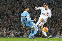 Gael Clichy competes with Gylfi Sigurdsson during the Barclays Premier League Match between Manchester City and Swansea City played at the Etihad Stadium, Manchester on 12th December 2015