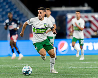 FOXBOROUGH, MA - AUGUST 26: Carlos Gomez #10 of Greenville Triumph SC brings the ball forward during a game between Greenville Triumph SC and New England Revolution II at Gillette Stadium on August 26, 2020 in Foxborough, Massachusetts.