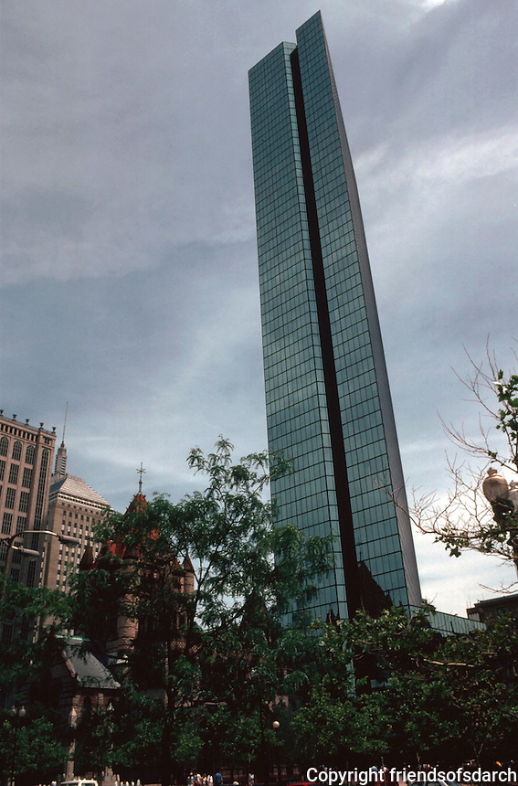 Boston:  The Hancock, 200 Claredon, looming vertiginously over Trinity Church and Copley Square Plaza from Boylston St. 60 stories.  Henry N.  Cobb of I.M. Pei &  Partners. 1976.  Photo  '91.