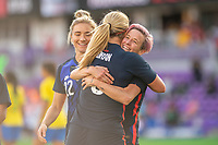ORLANDO CITY, FL - FEBRUARY 21: Lindsey Horan #9 and Megan Rapinoe #15 of the USWNT celebrate a goal during a game between Brazil and USWNT at Exploria Stadium on February 21, 2021 in Orlando City, Florida.