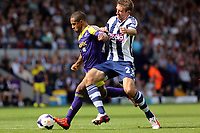 Sunday 01 September 2013<br /> Pictured L-R: Wayne Routledge of Swansea challenged by Gareth McAuley of West Brom. <br /> Re: Barclay's Premier League, West Bromwich Albion v Swansea City FC at The Hawthorns, Birmingham, UK.