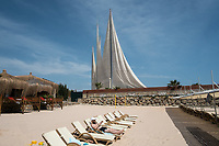 A man sunbathes on the beach in the male only area of the beach at the Adenya Hotel and Resort. Halal hotels have sex segregated swimming pools, beaches, and spa facilities.