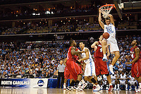 North Carolina's Tyler Hansbrough dunks over Louisville during the NCAA Basketball Men's East Regional at Time Warner Cable Arena in Charlotte, NC.